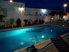 swimming_pool_lit_at_night.jpg