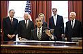 God save America-obama-signing-bill.jpg